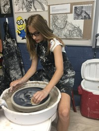 picture of student cleaning the wheel