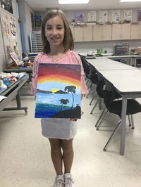 picture of student and their painting