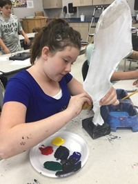 picture of student painting sculpture