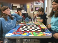 students playing chess and checkers