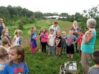 Students and teachers at a farm
