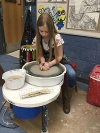 Student Using Clay Wheel